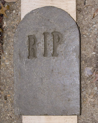Unmolded tombstone.
