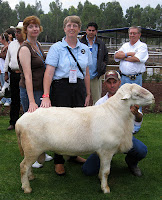 Me (center) and Dee Dee Allen (left) posing with a Katahdin ram at a farm in Mexico