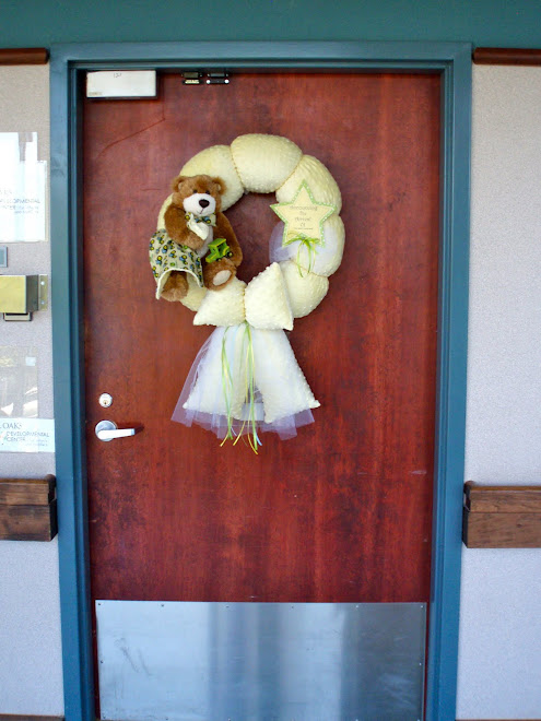A baby wreath on a hospital door.