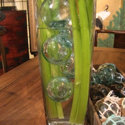fishing glass floats in vase