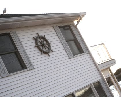 ship wheel on exterior wall - Exterior Home Decorations