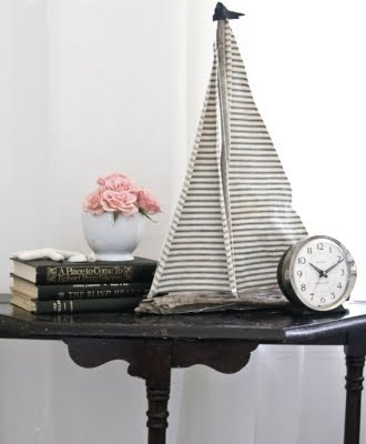 handmade driftwood sailboat with ticking fabric