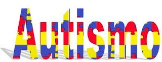 La palabra autismo con relleno del clásico puzzle de colores
