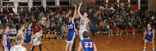 high school basketball game color photograph