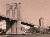 a black and white photograph of the Booklyn Bridge with Brooklyn in the background