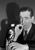 Humphrey Bogart as Sam Spade in The Maltese Falcon, book by Dashiell Hammett
