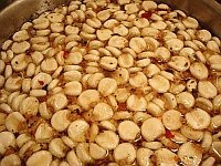 A color photo of nixtamal, dried corn kernels that have been cooked and steeped in an alkaline bath.