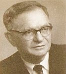 A black and white photo of Dr. David Diringer.