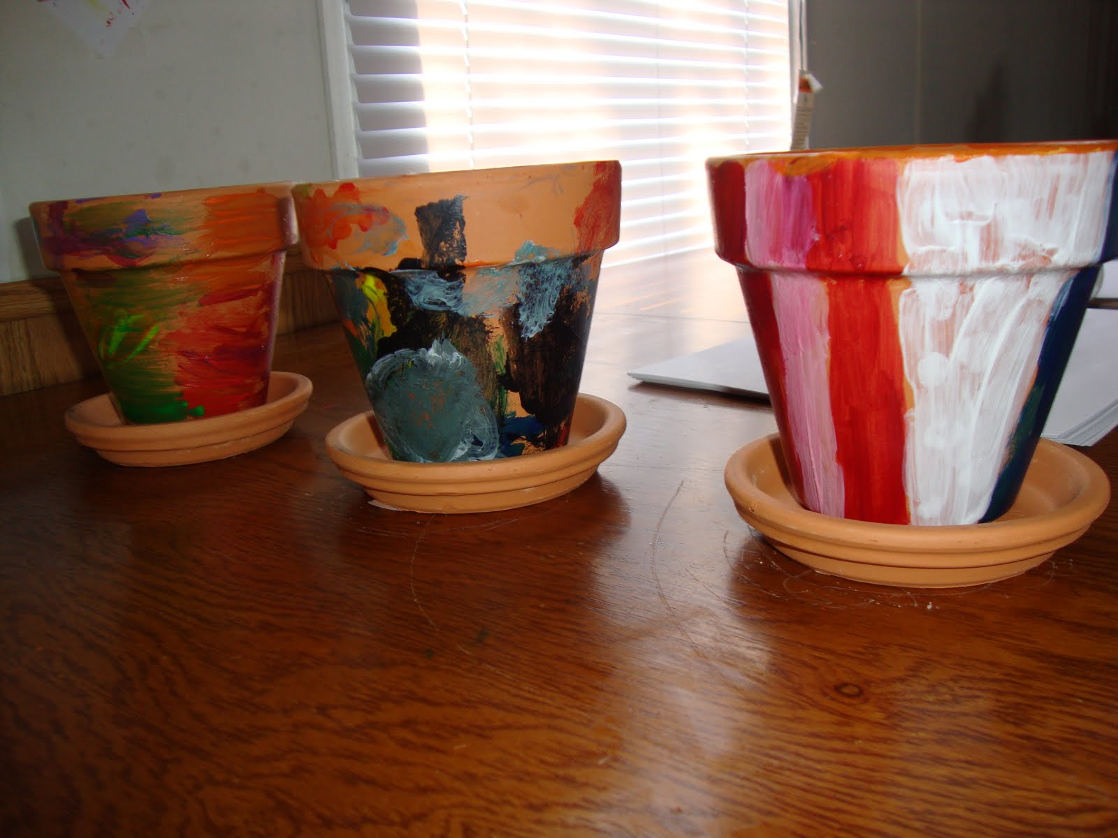 the dembkowski bunch painting clay pots. Black Bedroom Furniture Sets. Home Design Ideas