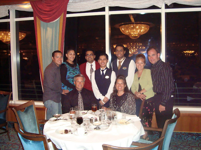 Our Head Waiter in Red, Main Waiter Noel next to me, Assistant Waiter Munir in front