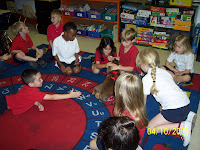 Children Sitting on a rug playing