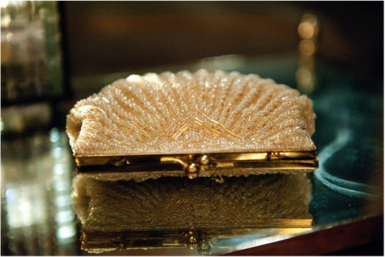 The bridal clutch is embellished by thousands of beads and resembles a