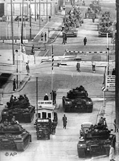 US tanks (foreground) face Soviet tanks at Checkpoint Charlie, on October 27-28, 1961