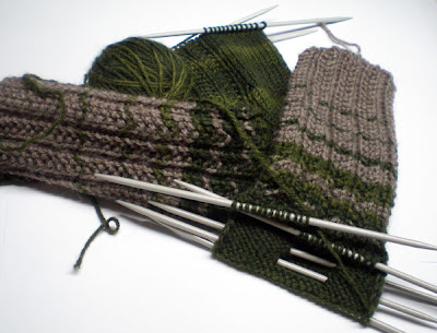beige and green knitted socks in progress