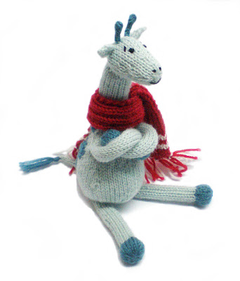 turquoise and teal knitted and crocheted giraffe with red and white scarf by Morrgan