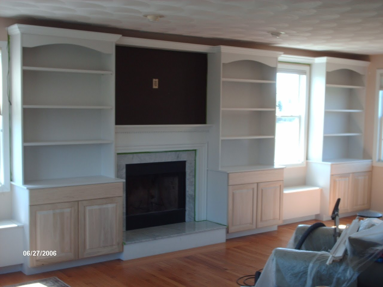 Custom built bookshelves car interior design for Custom built cabinets