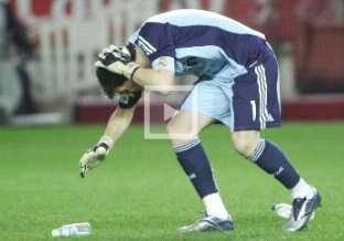 Iker Casillas drops himself to the pithc after a bottle hit on his head