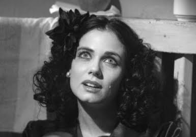 Mia Kirshner as Elizabeth Short, the BLACK DAHLIA