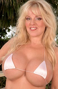 Huge Boobed Blonde In Tiny Bikini