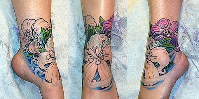 feminine-tattoo-flower-on-foot