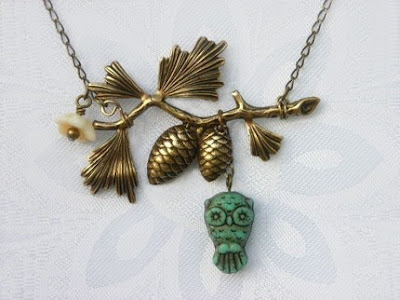 owl on a pine branch necklace from etsy