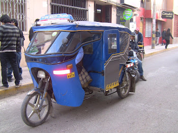 un triporteur de Puno