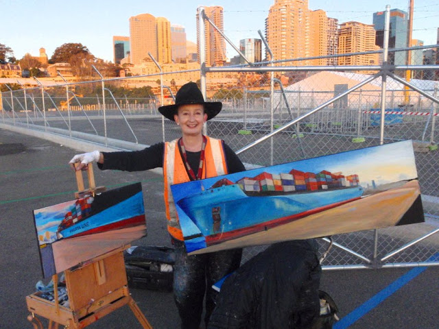 Jane Bennett with oil painting of container ship 'Maersk Gateshead' at Barangaroo