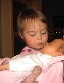 Savannah giving her sister kisses