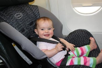 Having fun in sister's seat on the plane