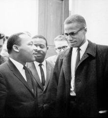 Dr. Martin Luther King, Jr confers with a close friend and constituent.