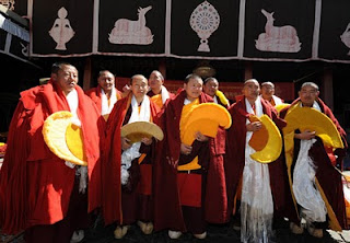 Hand picked Lamas receiving their Geshe Degree after passing their political exams