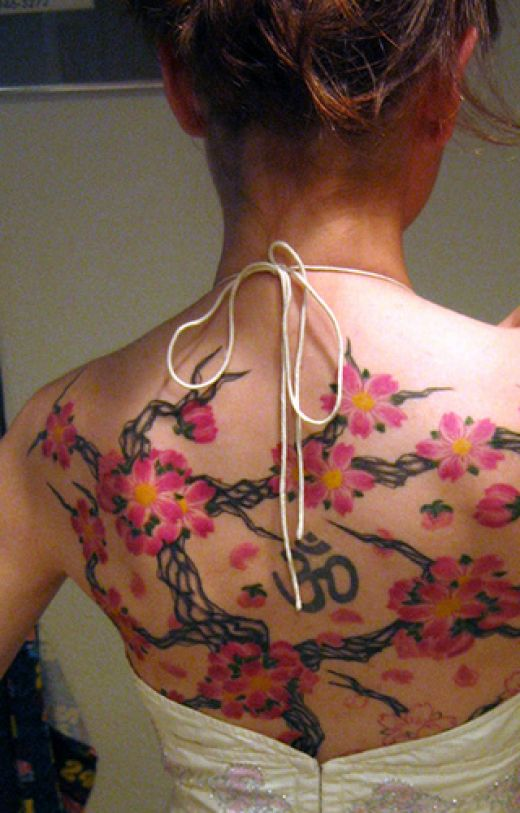 female back tattoo. upper ack tattoo designs for