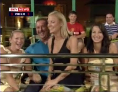 Wife of English cricketer Matt Prior sitting on Allen Stanford's laps