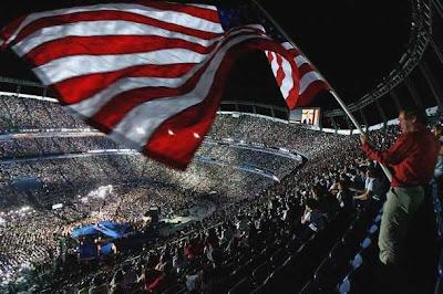 The flag flies at Mile High Stadium.