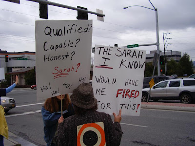 Protester at anti-Palin rally in Anchorage, Alaska. The sign reads: 'The Sarah I know would have me fired for this!'