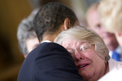 Woman cries while hugging Obama in Lima, Ohio