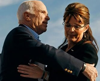 McCain and Palin embrace awkwardly at a campaign rally.