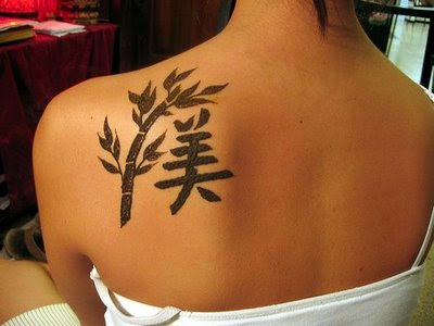 girl kanji tattoo design Online girl tattoo design Artistic girl tattoos