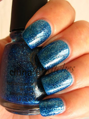 china glaze dorothy who wizard of ooh ahz returns blue jelly glitter nailpolish nailswatches swatch 2009