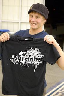 Mac stoked on his new Pyranha shirt