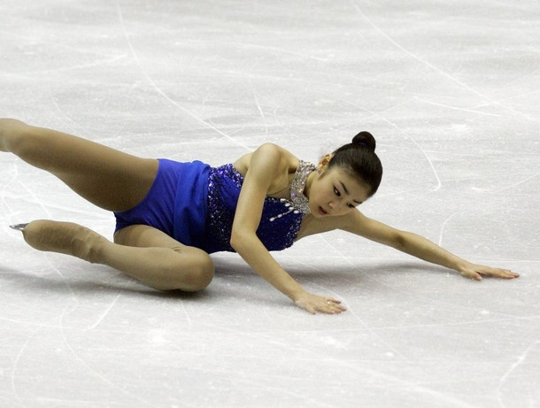 Kim Yu-Na falls on her triple flip during her free skate at Cancer.net