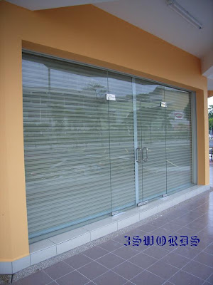 Tempered glass door and frameless fixed panel shop front having fixed glass panel frame less or with aluminium frame at the front of the shop premise serve as showcase besides giving brightness to the planetlyrics Gallery