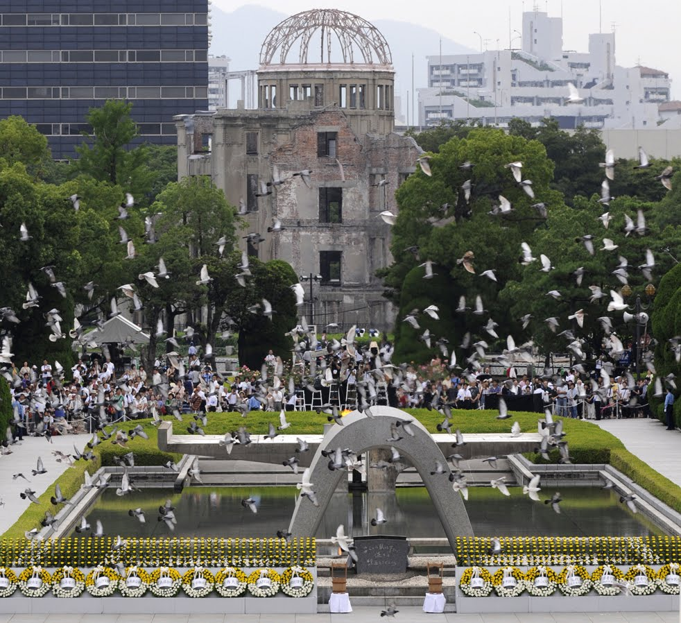 Doves fly around the Atomic Bomb Dome at the Peace Memorial Park after their ...