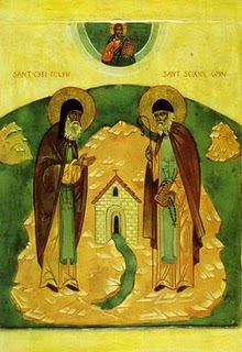 De hellige Cybi og Seiriol møtes ved de hellige kildene i Clorach midt på Anglesey