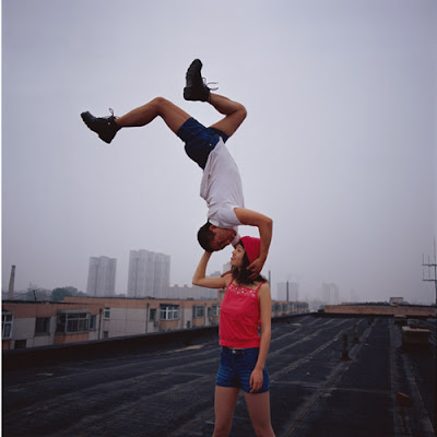 Lei Wei photo, man kissing a woman upside down