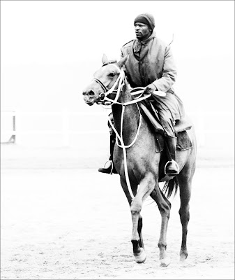 black and white picture black man riding an horse