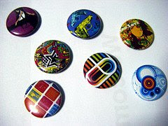 original badges designed by singaporean artist