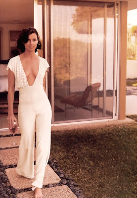 Bridget Moynahan white lowneck walking
