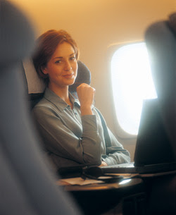 woman seated on plane