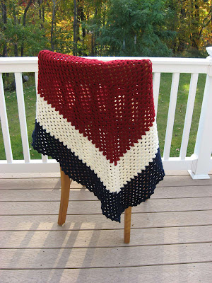 crocheted red, white and blue shawl